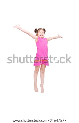 Happy cute girl in white clothes is jumping isolated