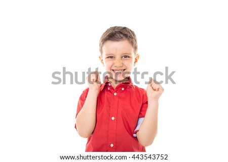 Happy cute little boy celebrating over white background