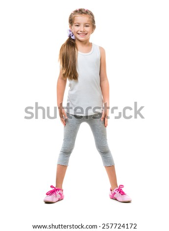 happy cute little girl goes in for sports on a white background isolated - stock photo