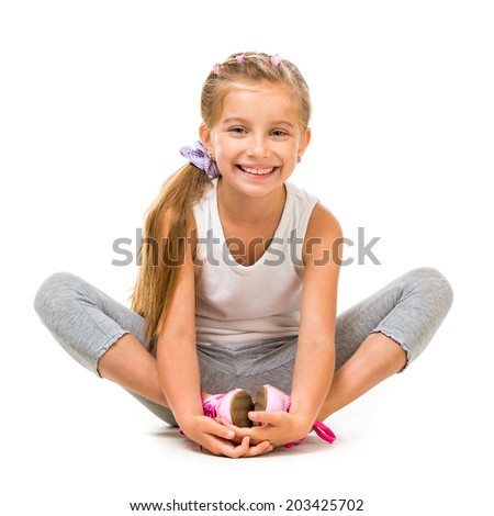 happy cute little girl goes in for sports. studio shot - stock photo