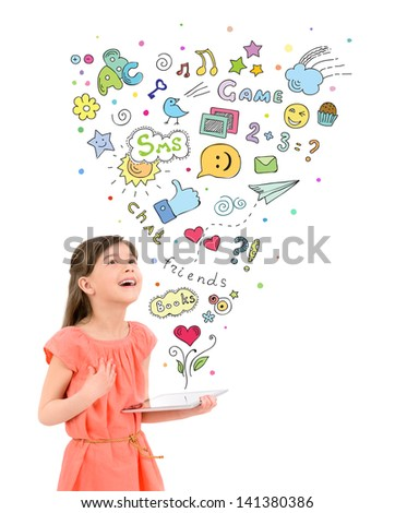 Happy cute little girl in red dress holding a digital tablet in hand and fascinated looking up at the colorful icons of different entertainment apps. Isolated on white background - stock photo