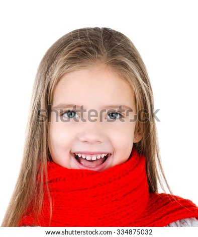 Happy cute little girl in red scarf isolated on white background - stock photo