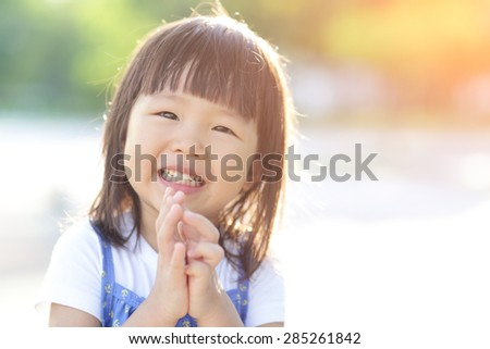 Happy Cute little girl on the meadow in summer day, asian - stock photo