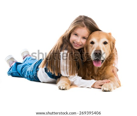 Happy cute little girl with her dog golden retriever - stock photo