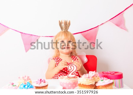 happy cute little girl with sweets at birthday party - stock photo