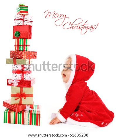 Happy, cute, smiling Christmas  baby sitting with gifts isolated on white. - stock photo