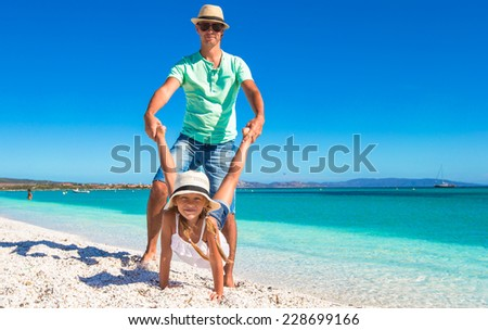 Happy dad and little girl have fun on tropical vacation - stock photo