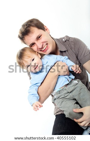 happy dad hugging his little son - stock photo
