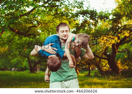 Happy dad playing with his  active children