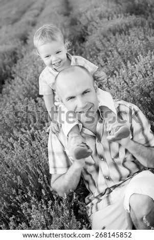 happy dad with baby son in lavender field  ( black and white )