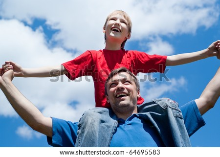 happy dad with son in the park - stock photo