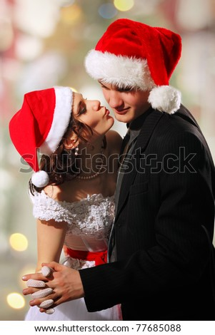 Happy dancing christmas young bride and groom - stock photo