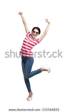Happy dancing teenager with arms up, isolated on white. Vagaries of fashion - stock photo