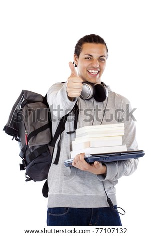 Happy dark-skinned student with books holds thumb up.Isolated on white background. - stock photo