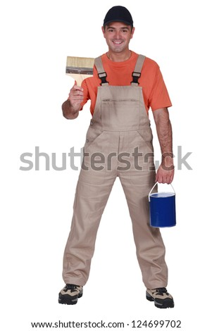Happy decorator with brush and pot - stock photo