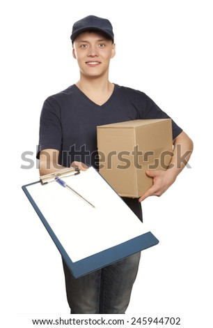 Happy delivery man showing form on clipboard over white background - stock photo
