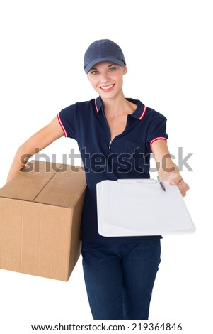Happy delivery woman holding cardboard box and clipboard over white background - stock photo