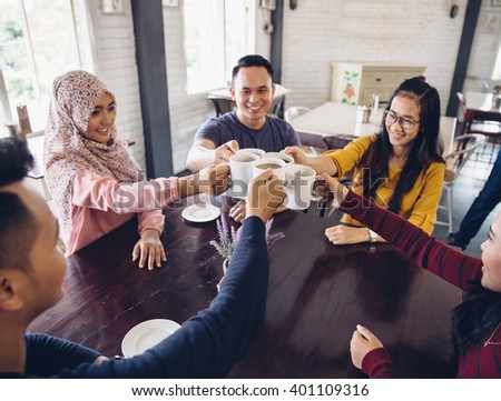happy Diverse Friends Cheering With Coffee at cafeteria - stock photo