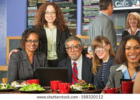 Happy diverse group of business people meeting for lunch - stock photo