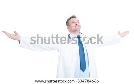 Happy doctor or medic raising hands outspread and outstretched isolated on white background - stock photo