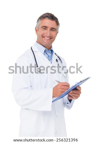 Happy doctor writing on clipboard on white background