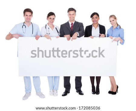 Happy Doctors And Businesspeople Holding White Billboard Over White Background - stock photo