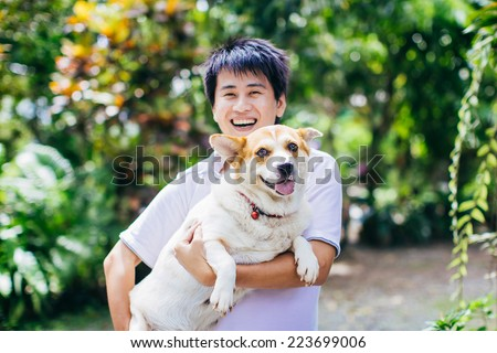 happy dog and her owner - stock photo
