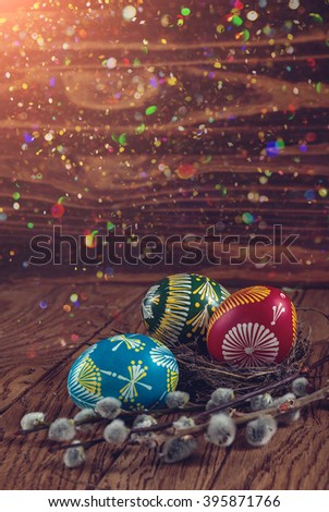 Happy Easter. colored Easter eggs and a branch blooming willow on the wooden background. Easter decoration