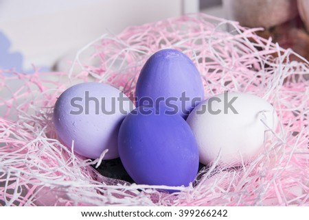 Happy Easter! Colorful Easter eggs in a basket - stock photo