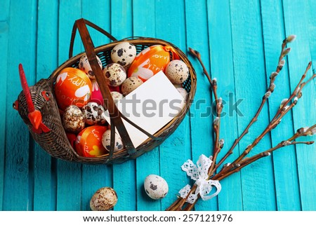 Happy easter concept. Basket with quail eggs and willow branch. Selective focus. Copy  space note - stock photo