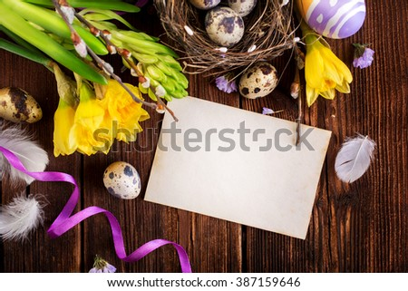 Happy Easter. Empty copyspace easter card and Easter decorations on a wooden background - stock photo