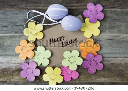 Happy Easter greeting card surrounded by Easter eggs and flowers. - stock photo