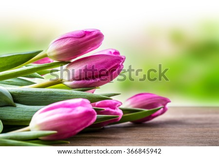 Happy easter. Multicolored spring tulips and Easter eggs. Spring and Easter decorations.  - stock photo