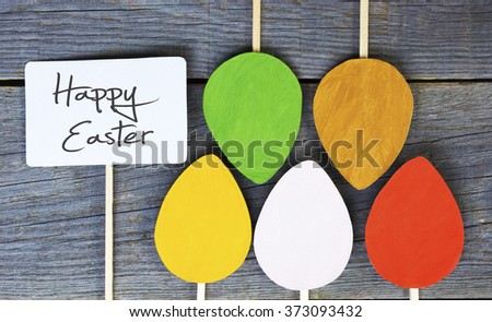 Happy Easter paper Easter egg and poster on wooden Background - stock photo