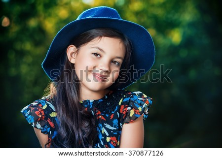 Happy eight year girl outdoor on a bright sunny day. Summer holidays. Kid's fashion. - stock photo