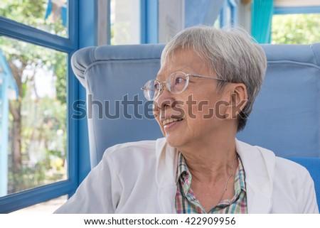 happy elder smile in living room  - stock photo