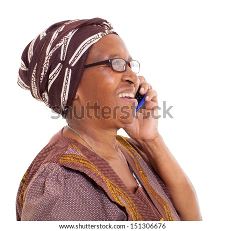 happy elderly african woman talking on smart phone on white background - stock photo