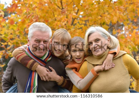 happy elderly couple and grandchildren together resting - stock photo