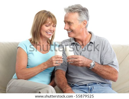 Happy elderly couple drinking milk, Over white background - stock photo