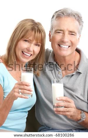 Happy elderly couple drinking milk. Over white background - stock photo