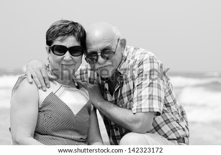 Happy elderly couple enjoying their retirement vacation near the sea - stock photo
