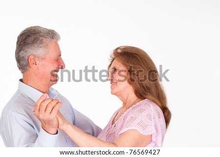 happy elderly couple on a white background