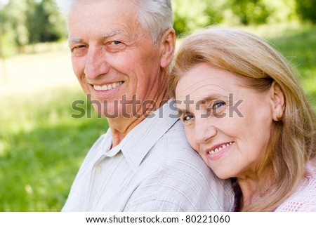 happy elderly couple posing at the nature