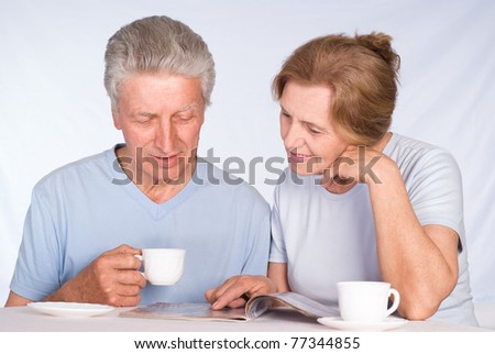 happy elderly couple  sitting at the table - stock photo