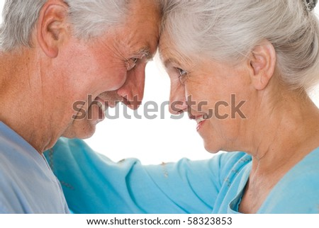 happy elderly couple together on a white background - stock photo