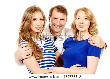Happy elderly parents standing with their adult daughter. Isolated over white. - stock photo