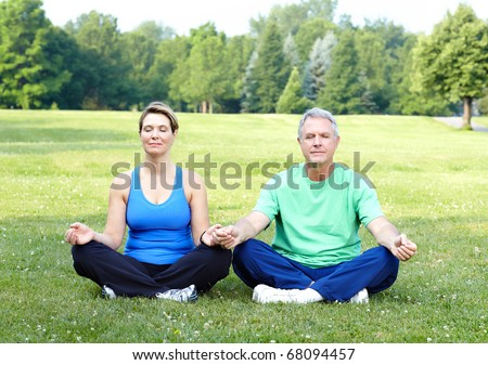 Happy elderly senior couple doing yoga - stock photo