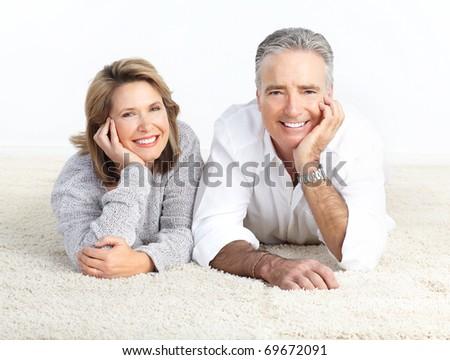 Happy elderly seniors couple at home - stock photo
