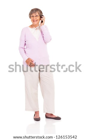 happy elderly woman talking on mobile phone isolated on white - stock photo