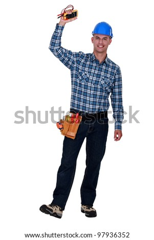 Happy electrician with multimeter in hand - stock photo